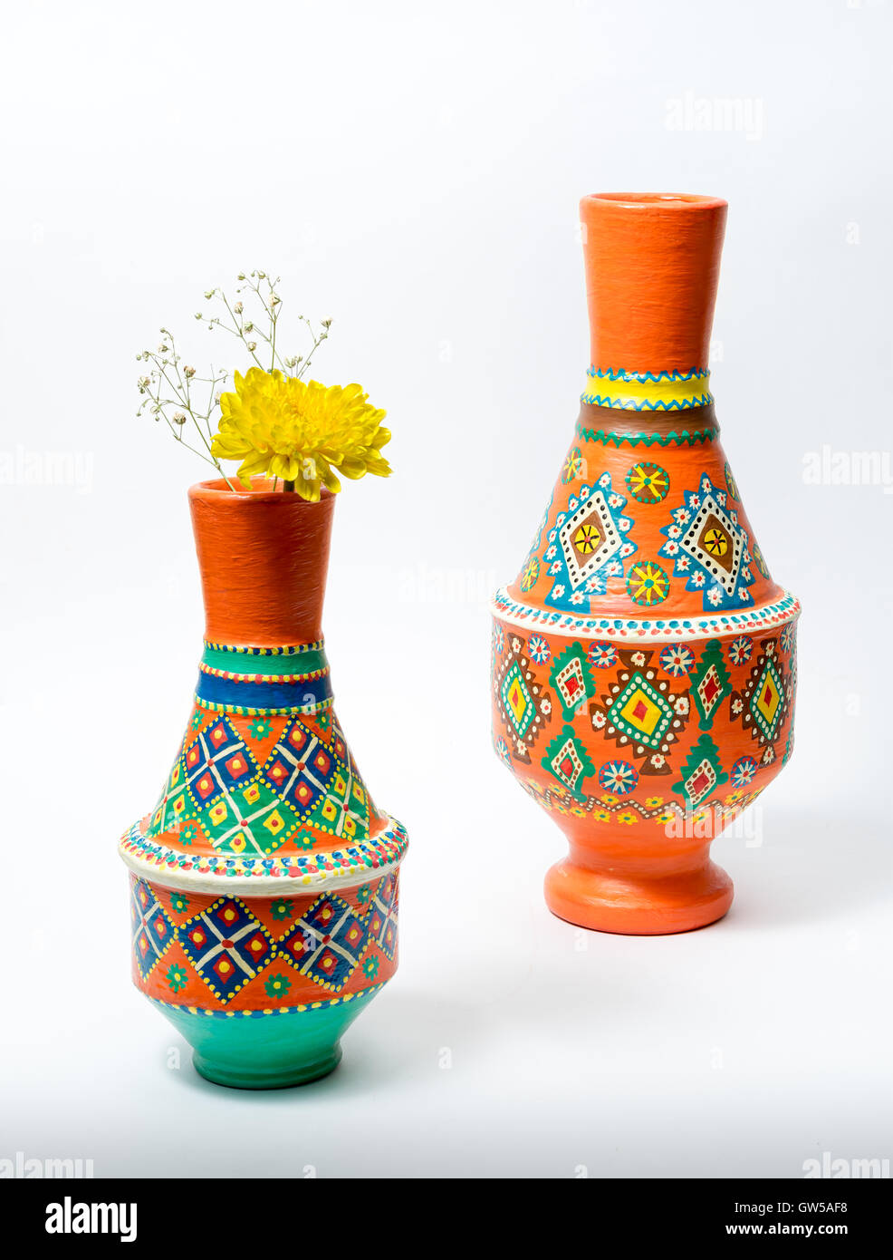 Still life composition of two colorful pottery vases with one still life composition of two colorful pottery vases with one yellow flower on white background reviewsmspy