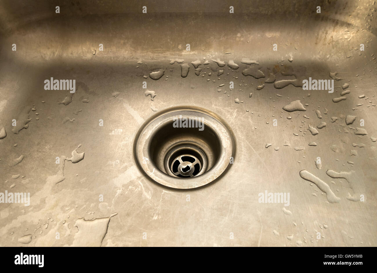 Empty Wet Kitchen Sink With Open Drain
