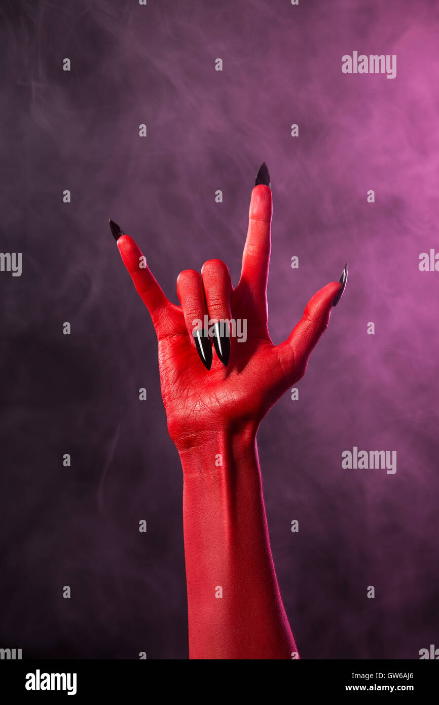 Rock sign red devil hand with black nails stock photo 118768670 rock sign red devil hand with black nails biocorpaavc Gallery