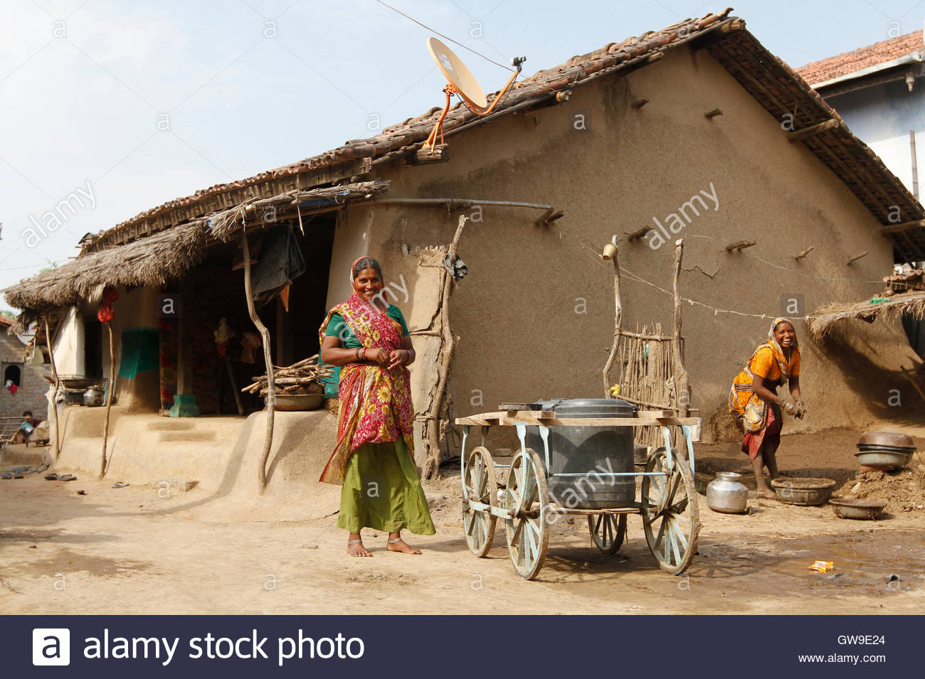 Villagers smile outside their mud house in khun village near dholera town in the western indian