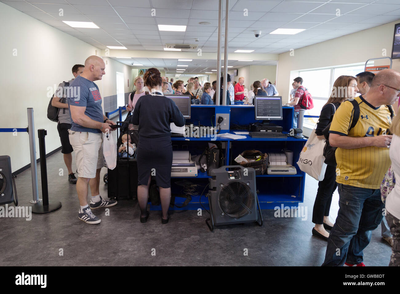 uk airport security passengers boarding pass checks at the gate stock photo royalty free. Black Bedroom Furniture Sets. Home Design Ideas