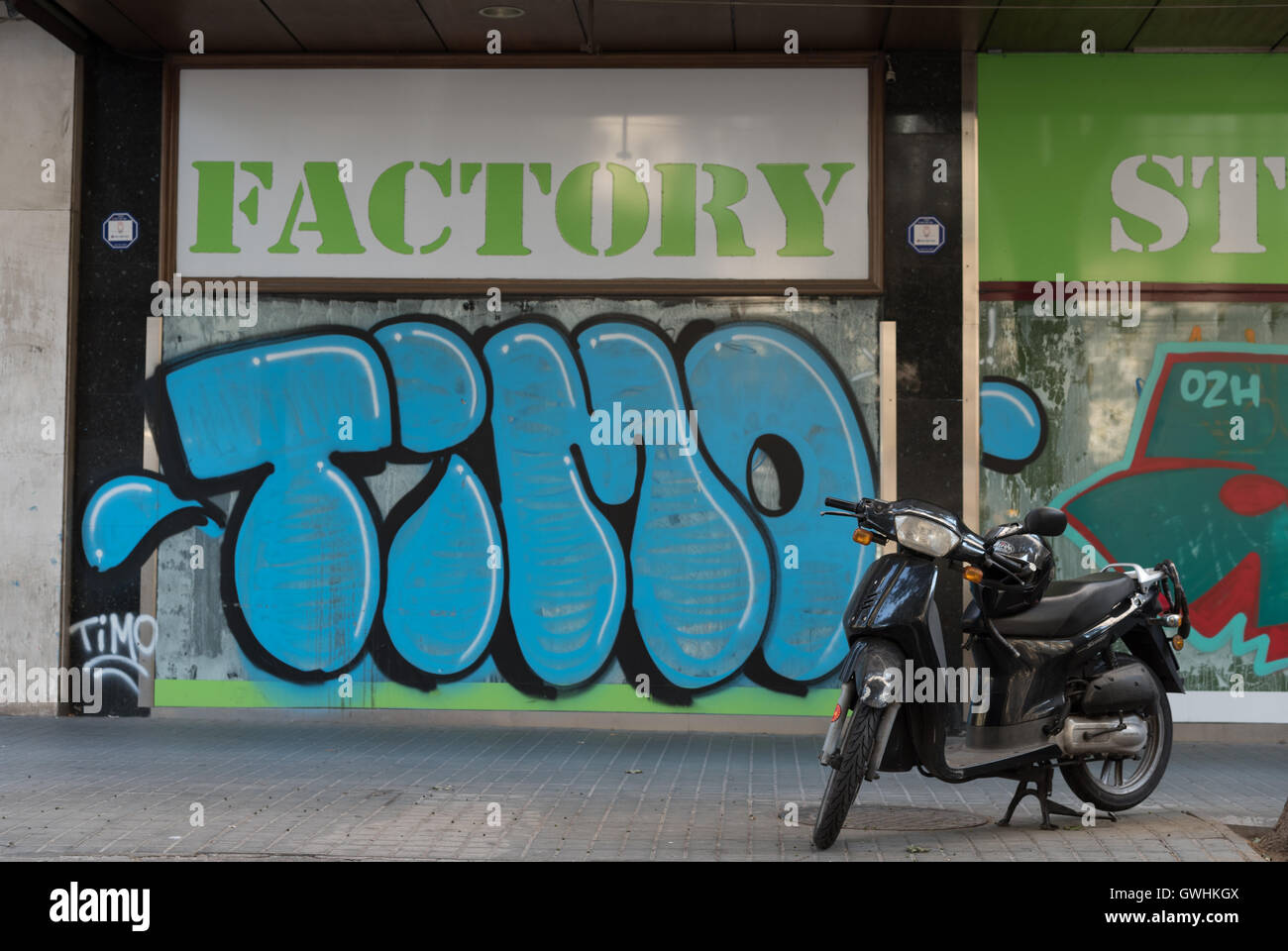 Graffiti wall barcelona - Graffiti Covered Shop Front And Motorbike In Barcelona The Store Name Factory And A Tag