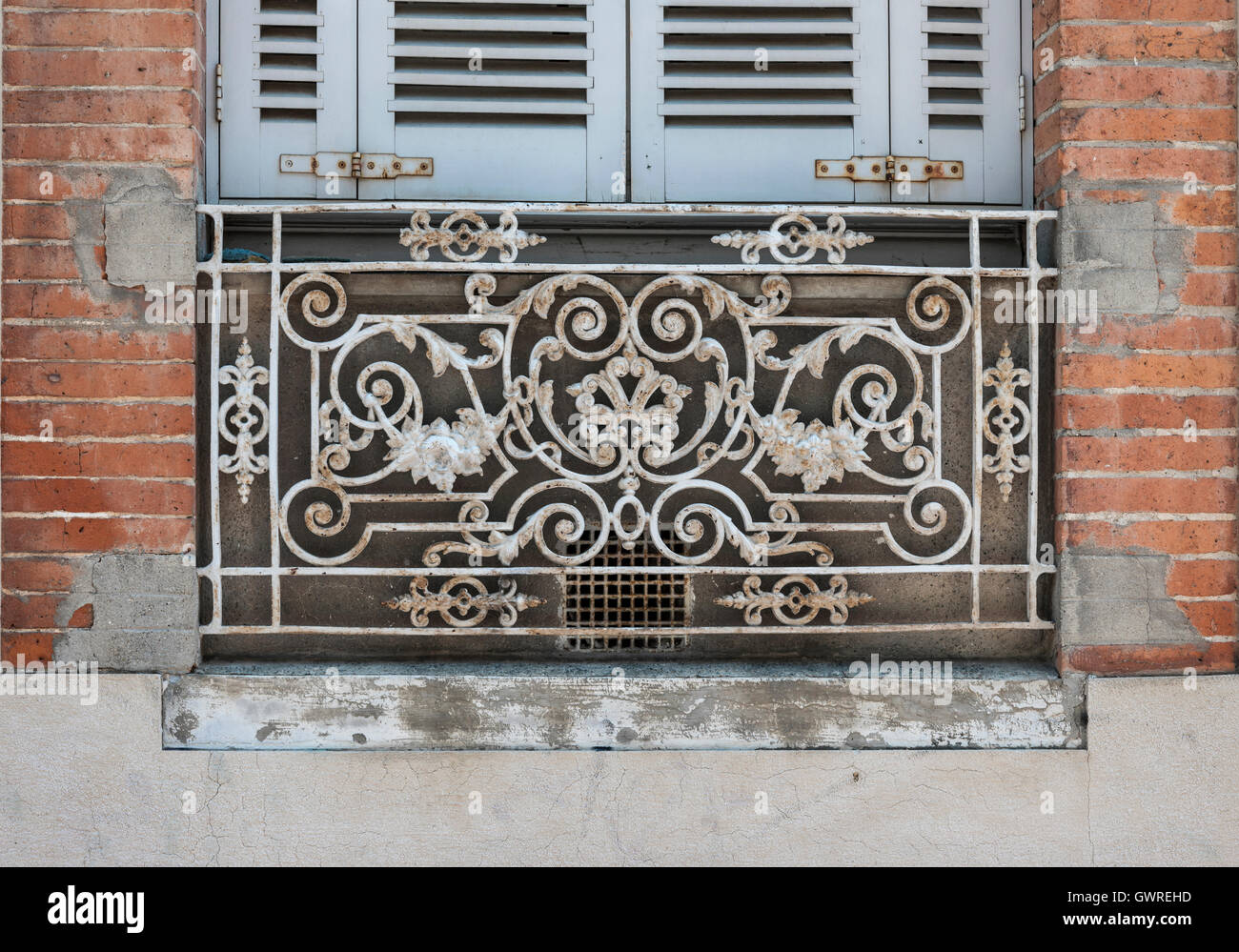 Window With Blue Shutters And Ornate Wrought Iron Window Box Or Balcony On  Old Brick Building In Toulouse, France