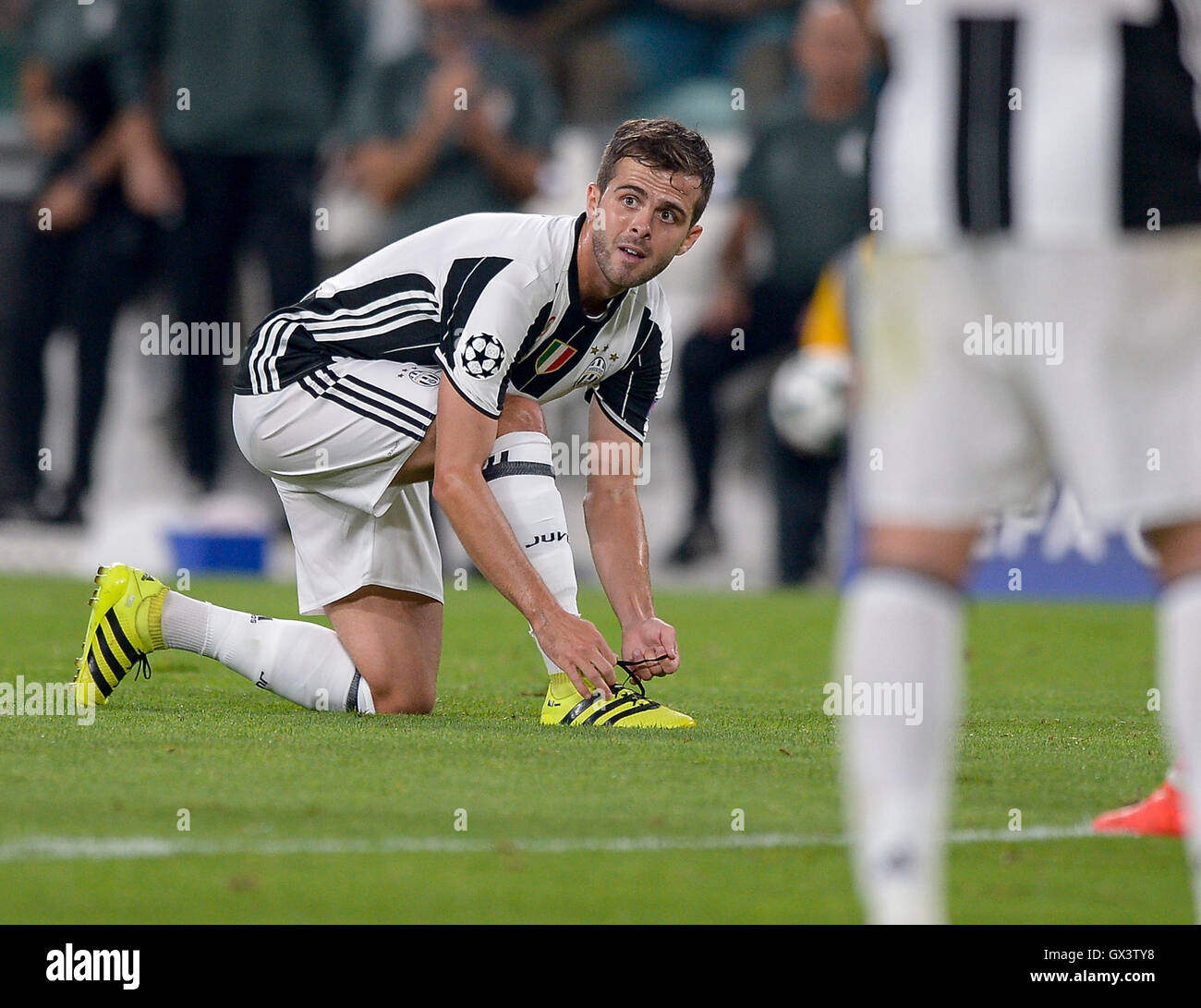 Turin Italy 14th Sep 2016 Miralem Pjanic fastens her shoes