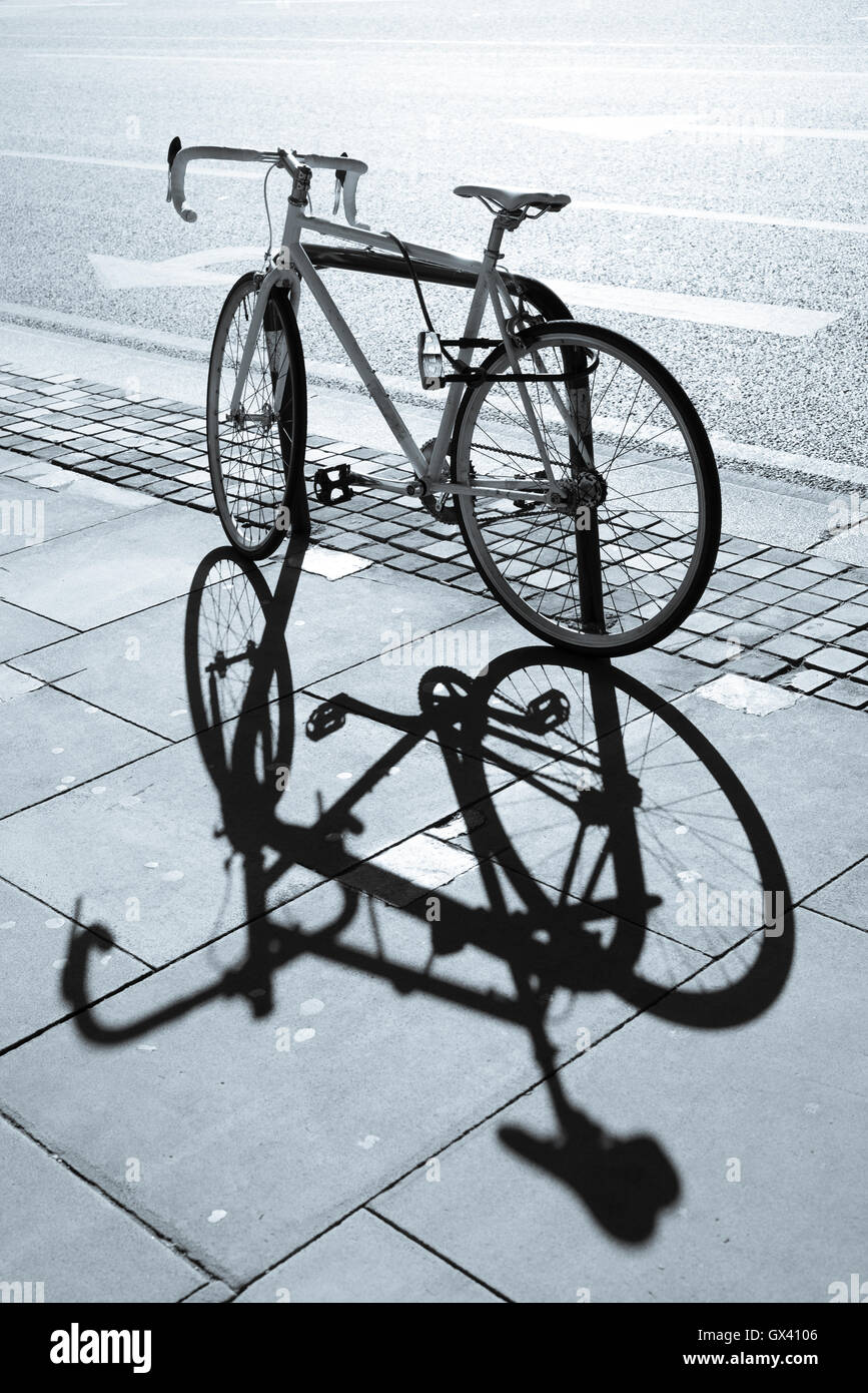 Hipster Single Gear Fixie Bicycle Locked To A Metal Stand On A