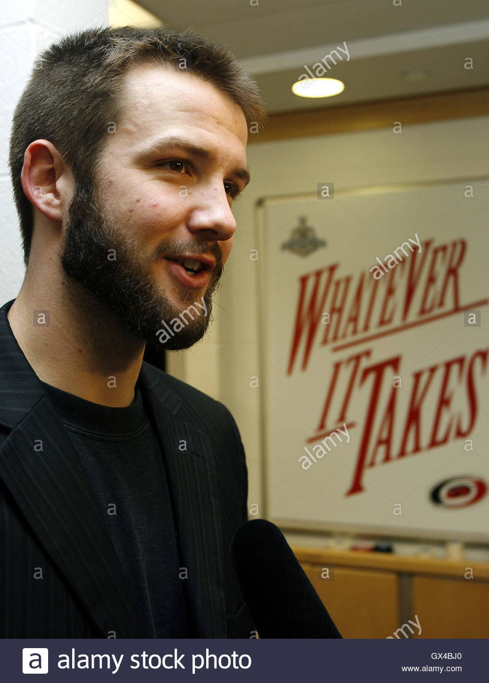 caroline hurricanes goalie cam ward answers reporters questions caroline hurricanes goalie cam ward answers reporters questions next to a motivational sign inside his team s