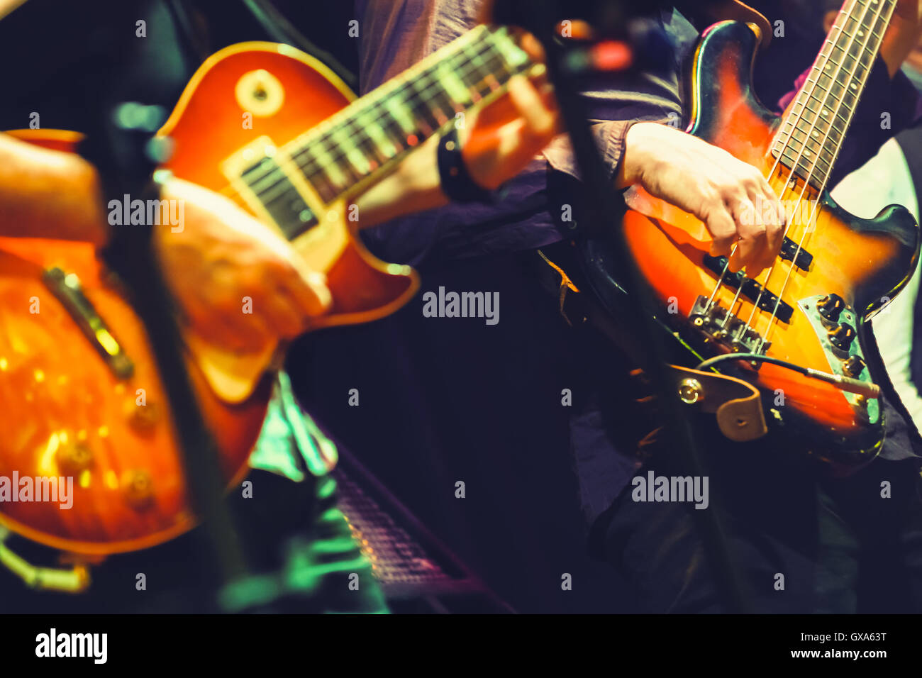 Colorful rock and roll music background, guitar players on ...