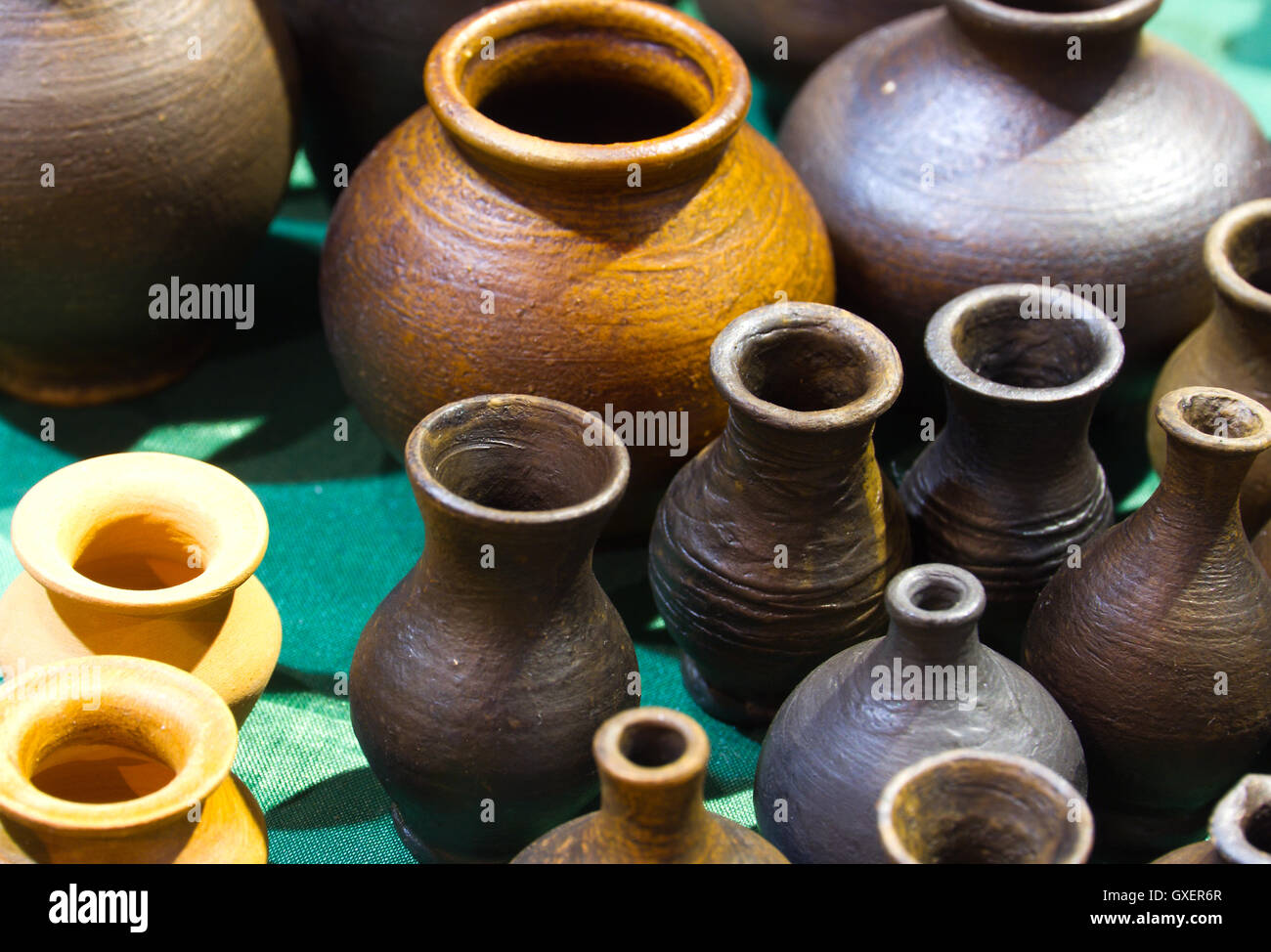 Handmade traditional russian ceramics (crockery things ware jugs pots) on the shopboard at the flea market in Moscow (Russia & Handmade traditional russian ceramics (crockery things ware jugs ...