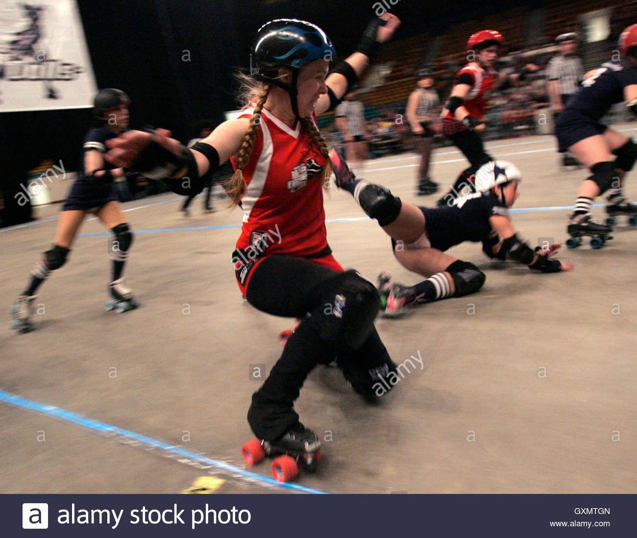 Roller skating denver -  Princess Slay Ya Of The Kansas City Roller Warriors L Trips Up Denver Roller Dolls Angela Death In Their Roller Derby Bout In Denver Colorado March 9