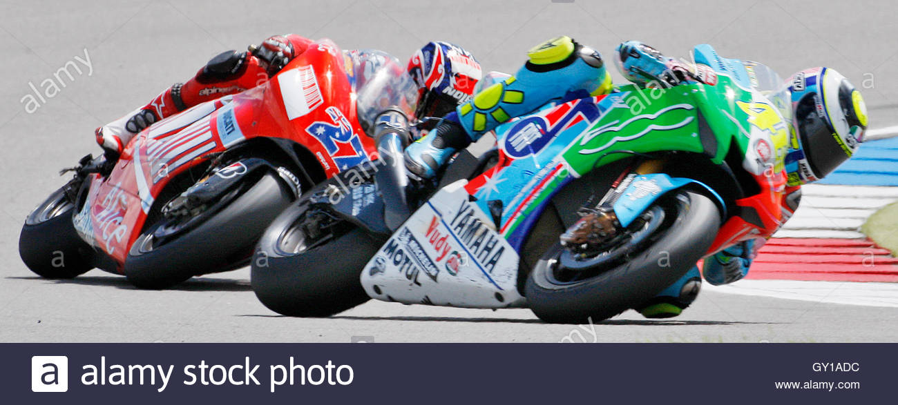 Yamaha MotoGP rider Valentino Rossi of Italy (R) and Ducati rider Stock Photo, Royalty Free ...