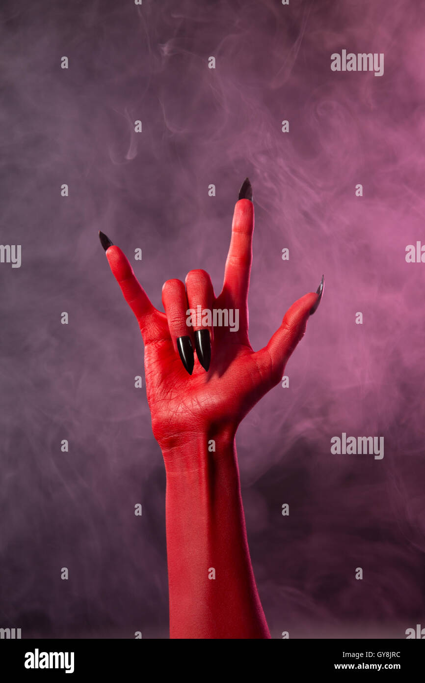 Heavy metal red devil hand with black nails stock photo heavy metal red devil hand with black nails biocorpaavc Gallery
