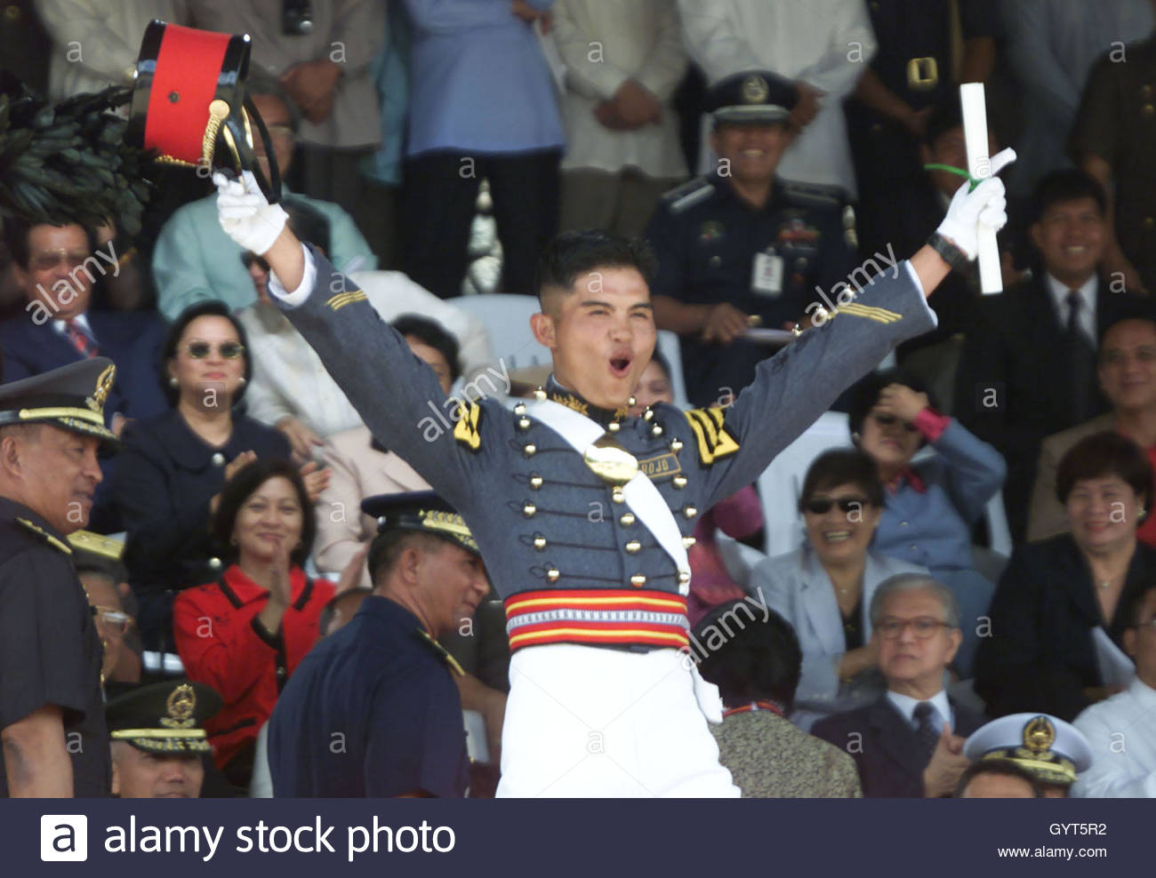 filipino military cadet waves to the crowd after graduating last filipino military cadet nasser arrojo waves to the crowd after graduating last