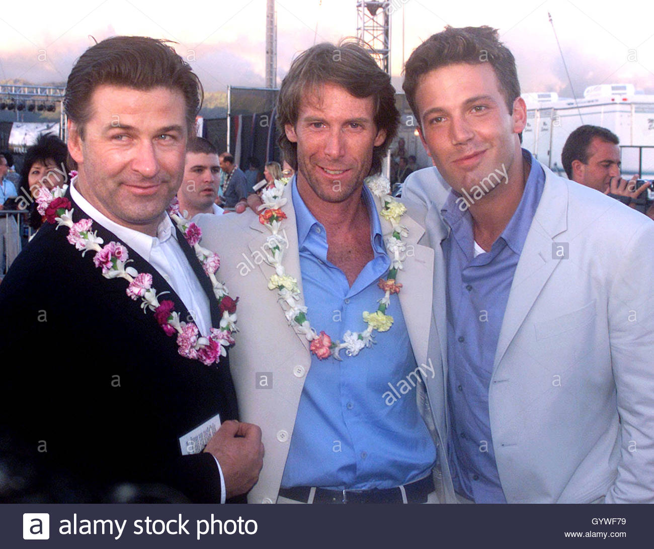 director and producer of the action drama film pearl harbor director and producer of the action drama film pearl harbor michael bay c poses cast members alec baldwin l and ben affleck in honolulu at pearl