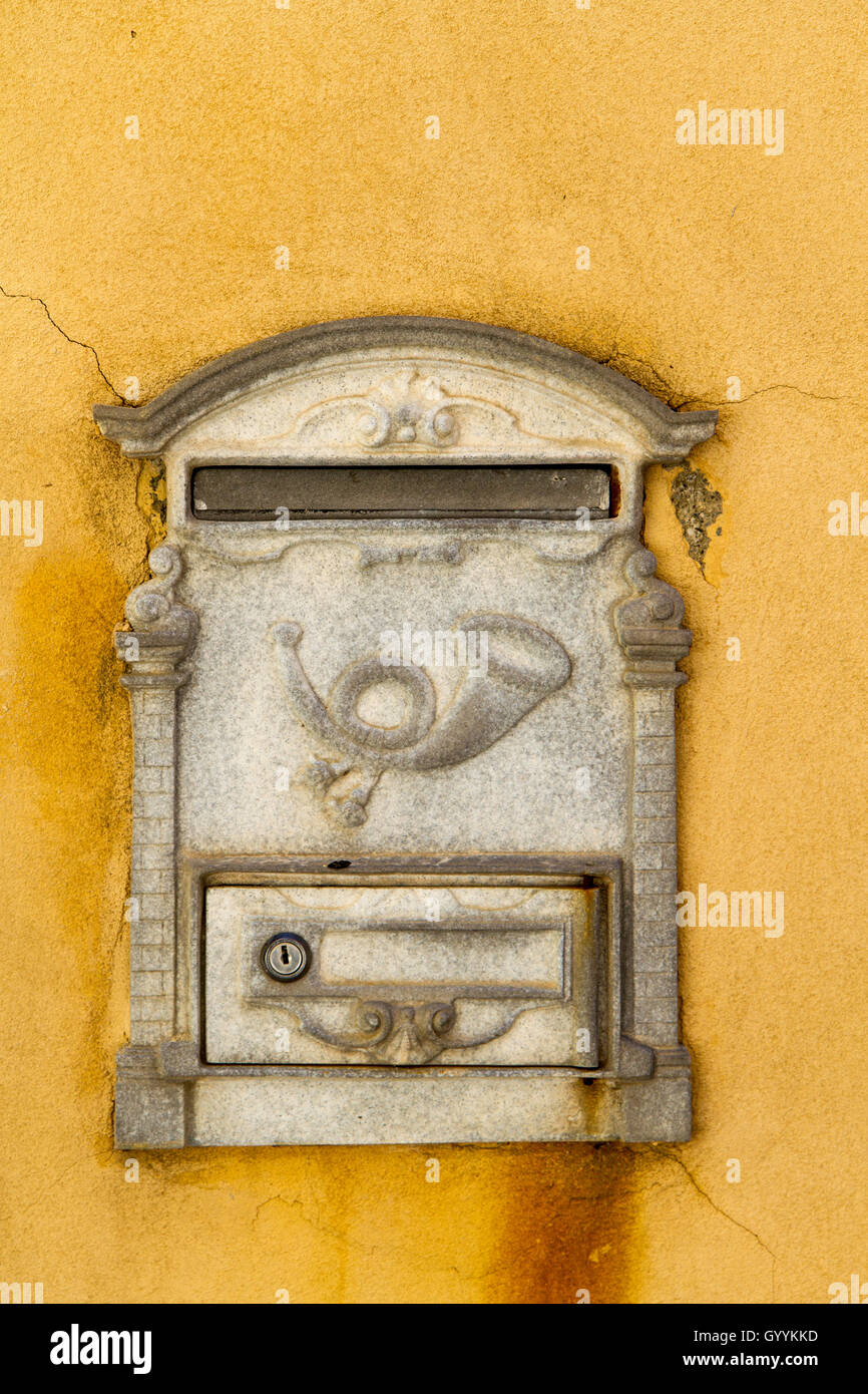 European Yellow Letterbox Decorative letterbox on the yellow wall of ...