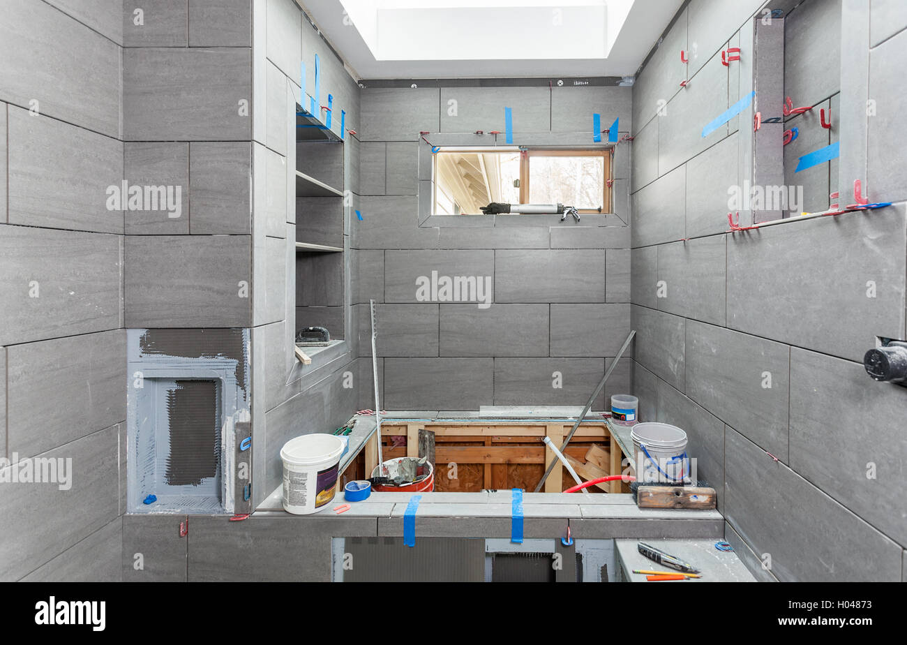 Tiling around tub, window and niches Stock Photo, Royalty Free ...