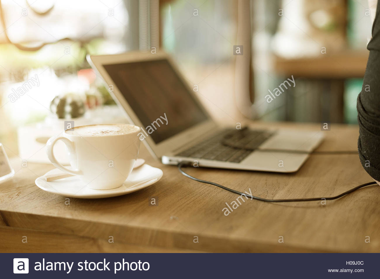 Blue print cafe stock photos blue print cafe stock images alamy blank screen mobile phone with matcha green tea and laptop computer on wooden table and soft malvernweather Gallery
