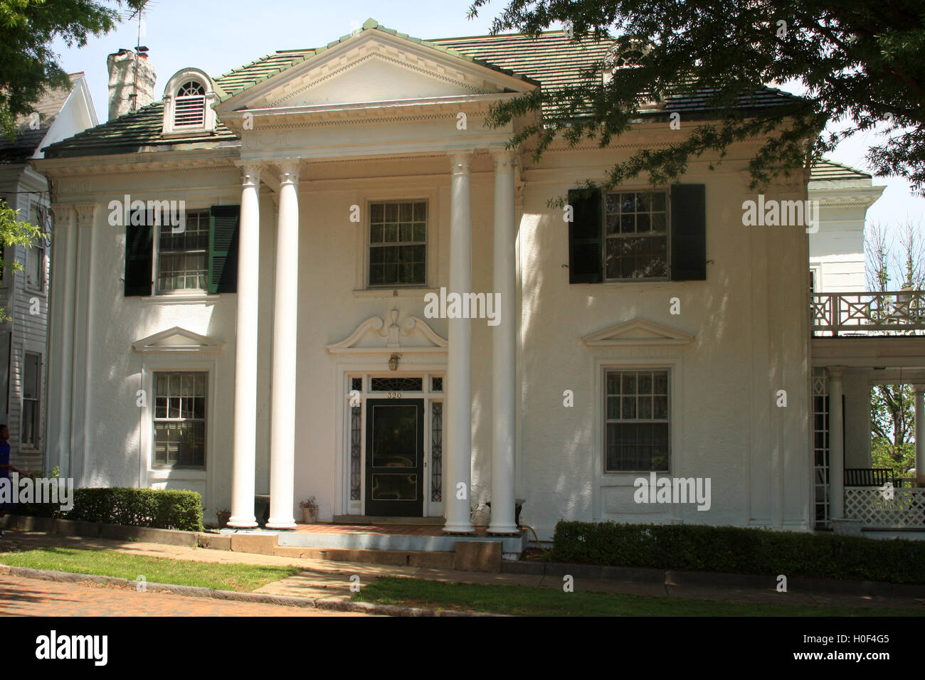 White house with columns in historic district of Lynchburg, Virginia