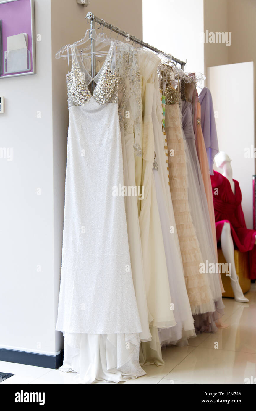 Wedding dresses on hangers in store stock photo royalty free wedding dresses on hangers in store ombrellifo Image collections