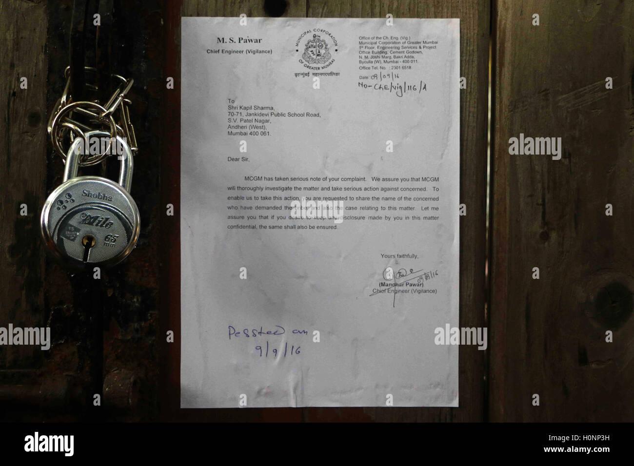 A Brihanmumbai Municipal Corporation (BMC) notice being put front door stand-up comedian Kapil Sharma office Versova Mumbai & A Brihanmumbai Municipal Corporation (BMC) notice being put front ...