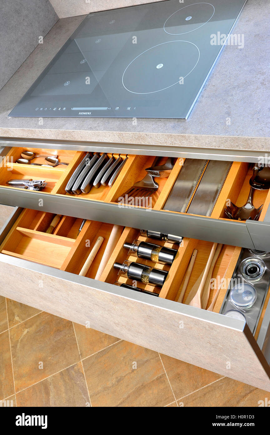 two organised and tidy modern kitchen drawer interiors with stock photo two organised and tidy modern kitchen drawer interiors with utensils and knives