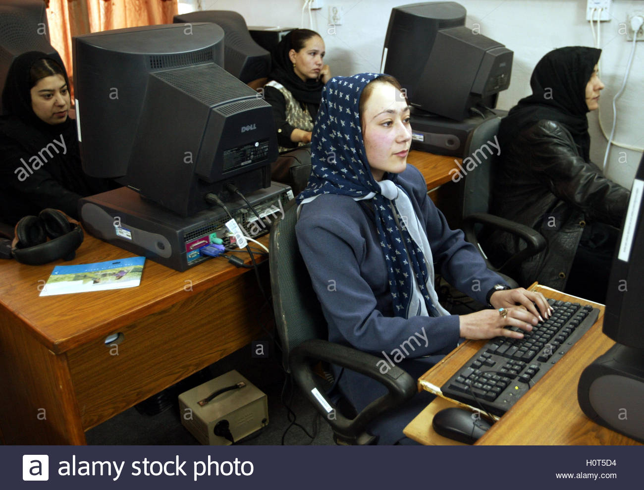 akbari stock photos akbari stock images alamy nabila akbari front and other young afghani girls sit before computer terminals at kabul
