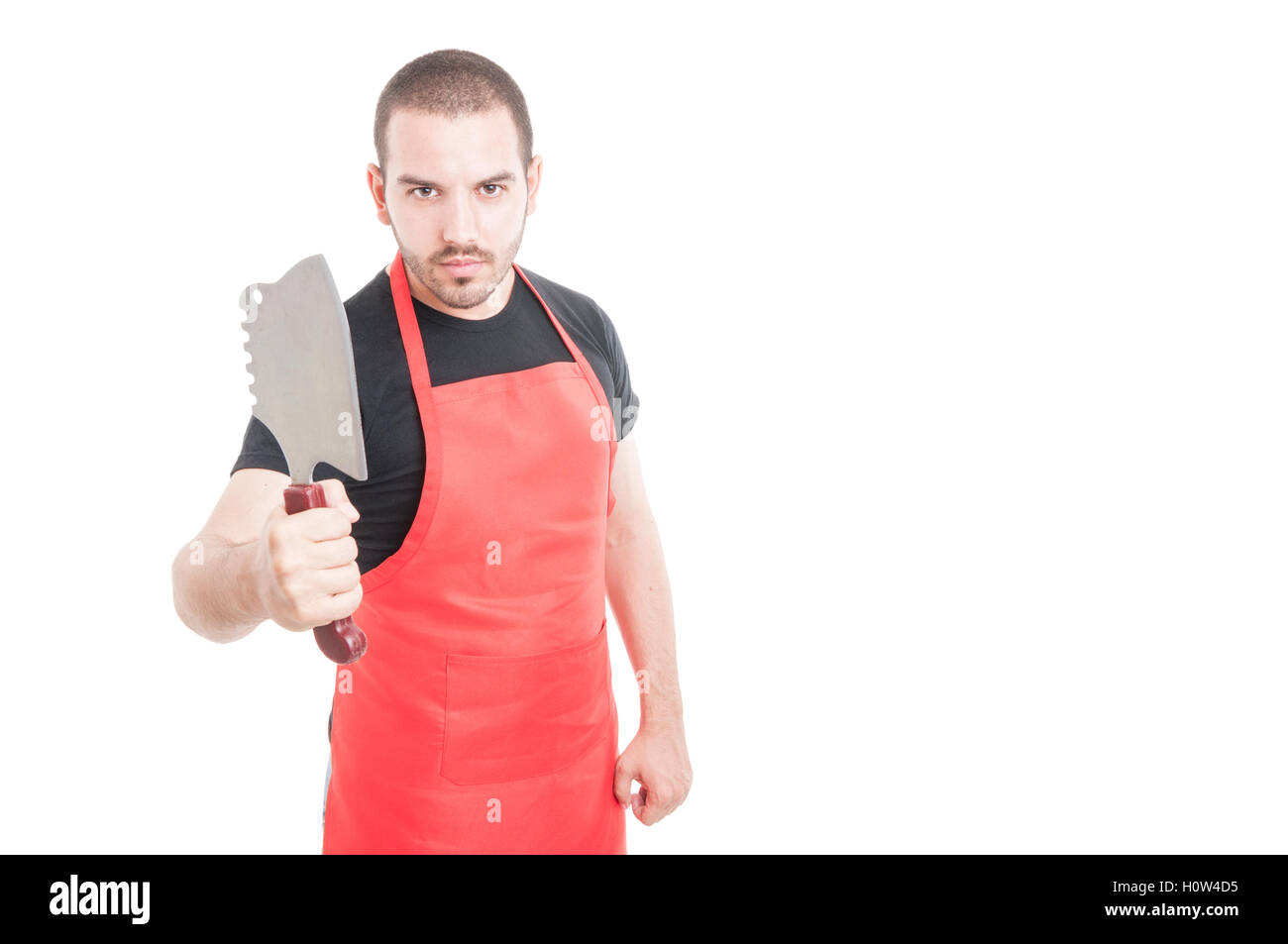 White apron meats - Serious Male Butcher In Red Apron Showing Meat Chopper On White Background With Advertising Area