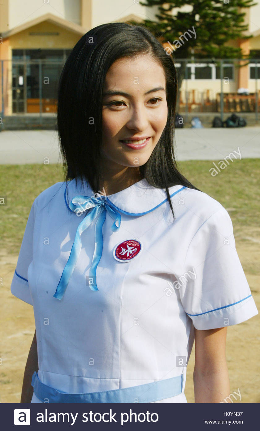 hong kong actress teresa cheung poses at a news conference to hong kong singer actress cecilia cheung poses at a school in hong kong before filming