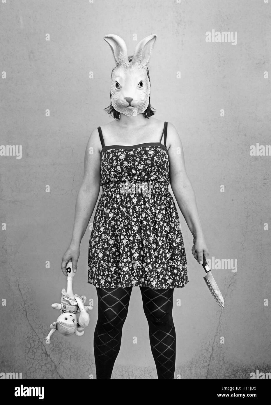 Girl in halloween rabbit mask, fear and terror Stock Photo ...