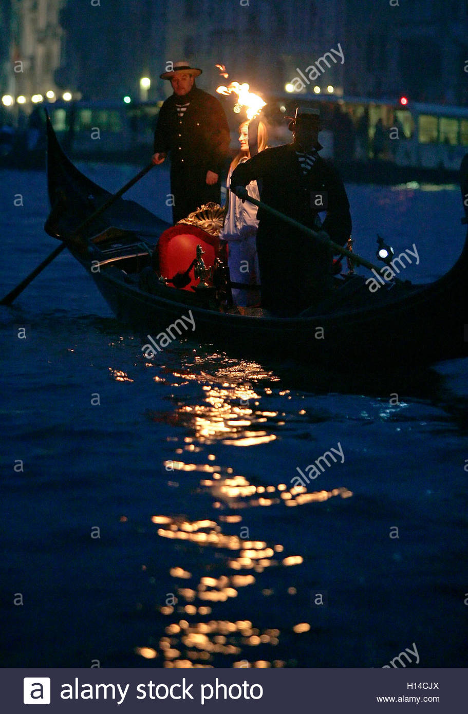 italian runner manuela levorato carries the olympic torch in a italian runner manuela levorato carries the olympic torch in a gondola past st marco square in venice 17 2006 about 10 000 torchbearers will take