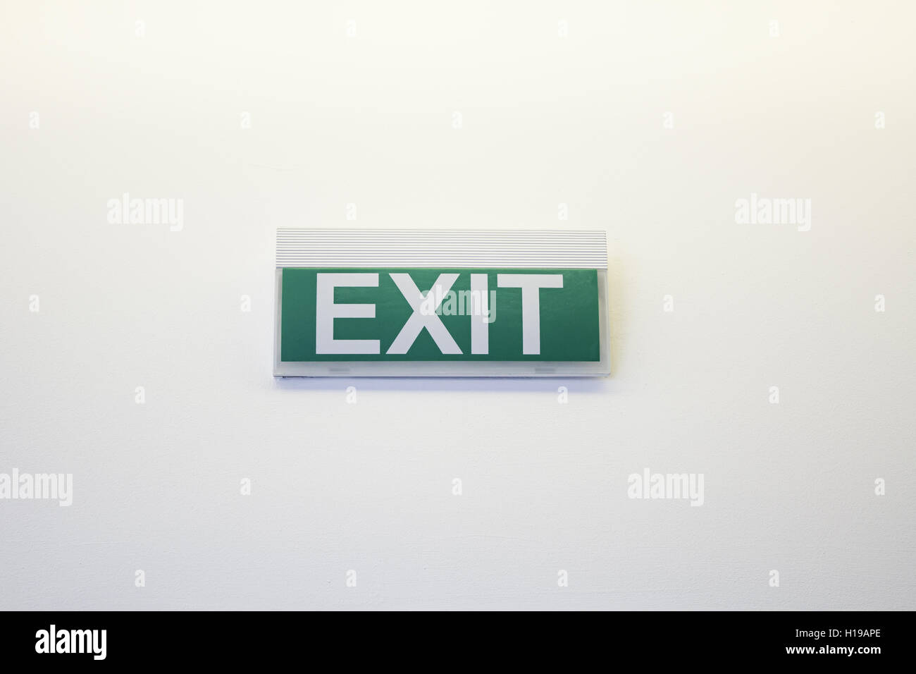 Exit sign on white wall symbol stock photo royalty free image exit sign on white wall symbol buycottarizona Images