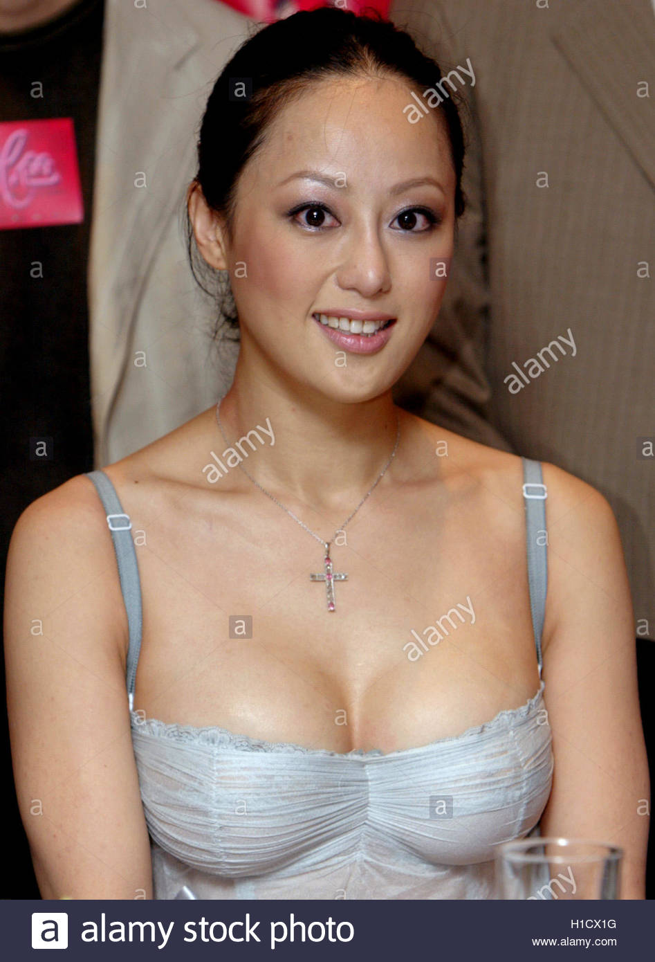 hong kong actress teresa cheung poses at a news conference to hong kong actress teresa cheung poses at a news conference to promote her new film colour blossoms in hong kong 11 2004