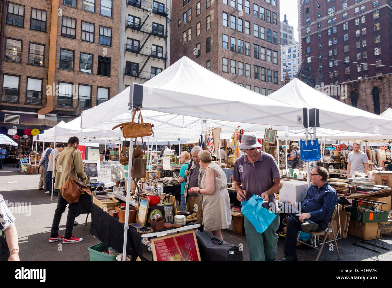 Manhattan New York City NYC NY Chelsea Chelsea Flea Market weekly open-air market shopping antiques collectibles tent vendors booths stalls woman man & Manhattan New York City NYC NY Chelsea Chelsea Flea Market weekly ...