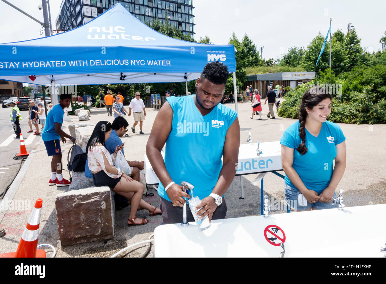 Brooklyn New York City NYC NY Dumbo Brooklyn Bridge Park NYC Water Tent Portable  Water Fountain Hydrate Public Service Black Man Woman Young Adult