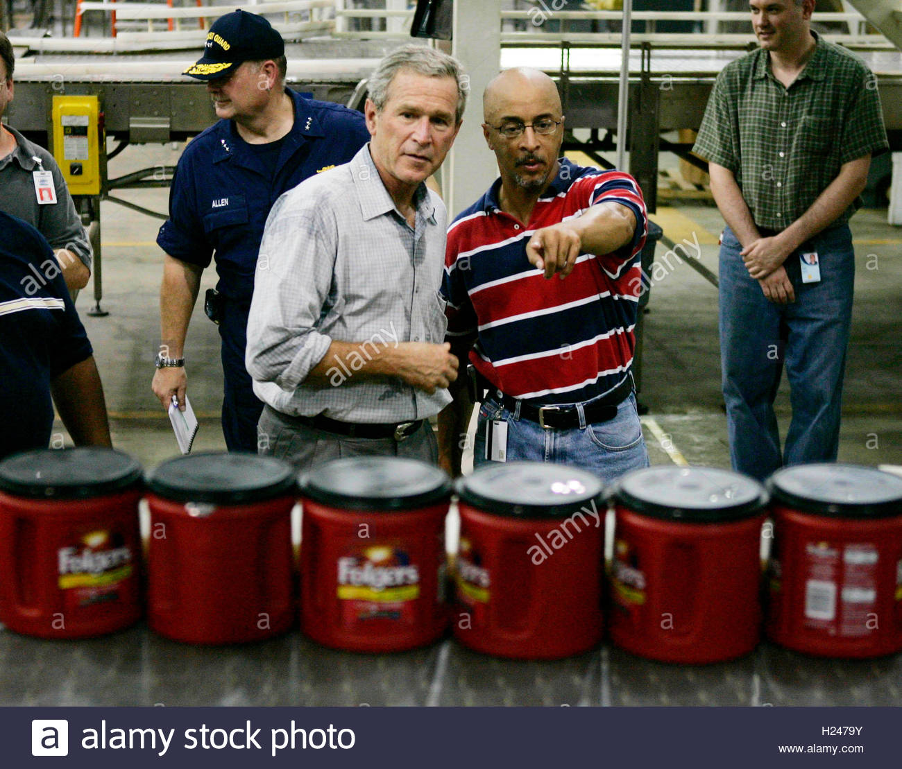 u s president george w bush is shown around at the stock photo u s president george w bush is shown around at the back in operation folgers coffee plant by operations manager bart blackstone r in new orleans