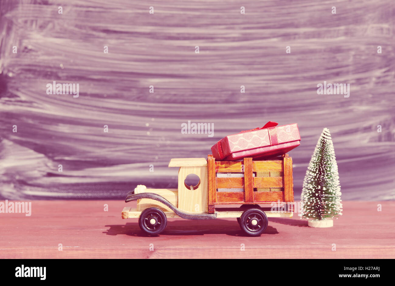 Christmas BackgroundToy Truck Car Carries Gifts And A Tree