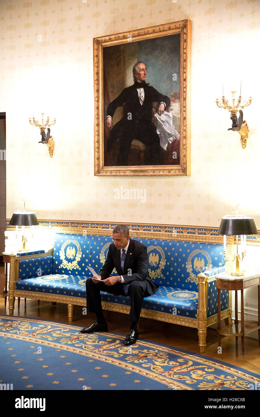 US President Barack Obama Reviews His Notes In The White House Blue Room Before Africa Leaders Summit Dinner August 5 2014 Washington DC