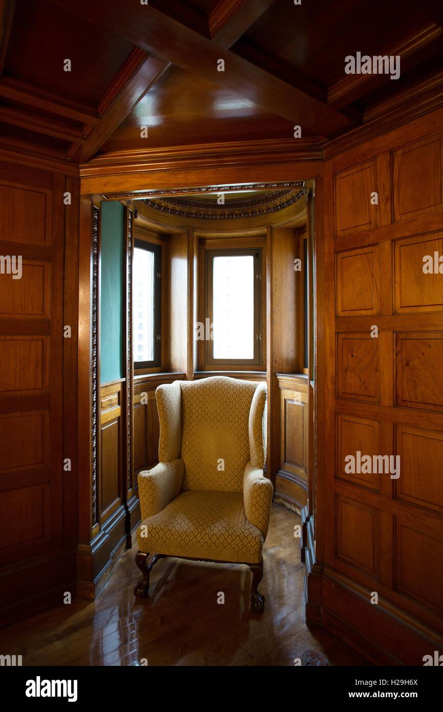 Empty chair in room - An Empty Chair In A Corner Of A Fancy Room In An Old Building