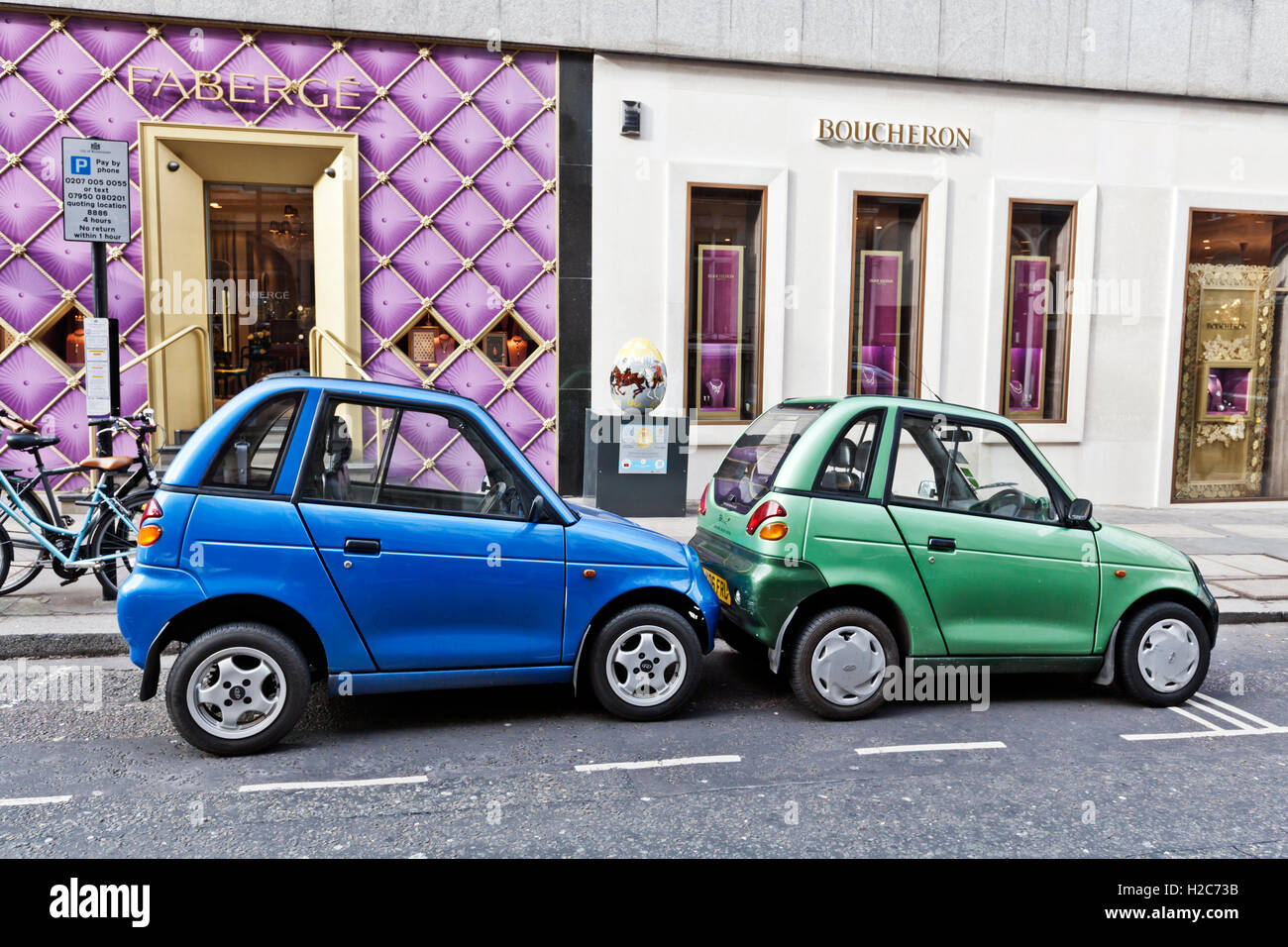 Two Cute G Wiz Electric Cars Share Parking Space Mayfair London