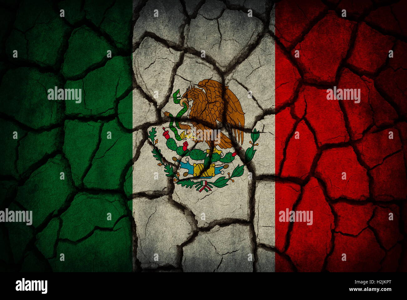 mexico flag painted on cracked soil stock photo royalty free
