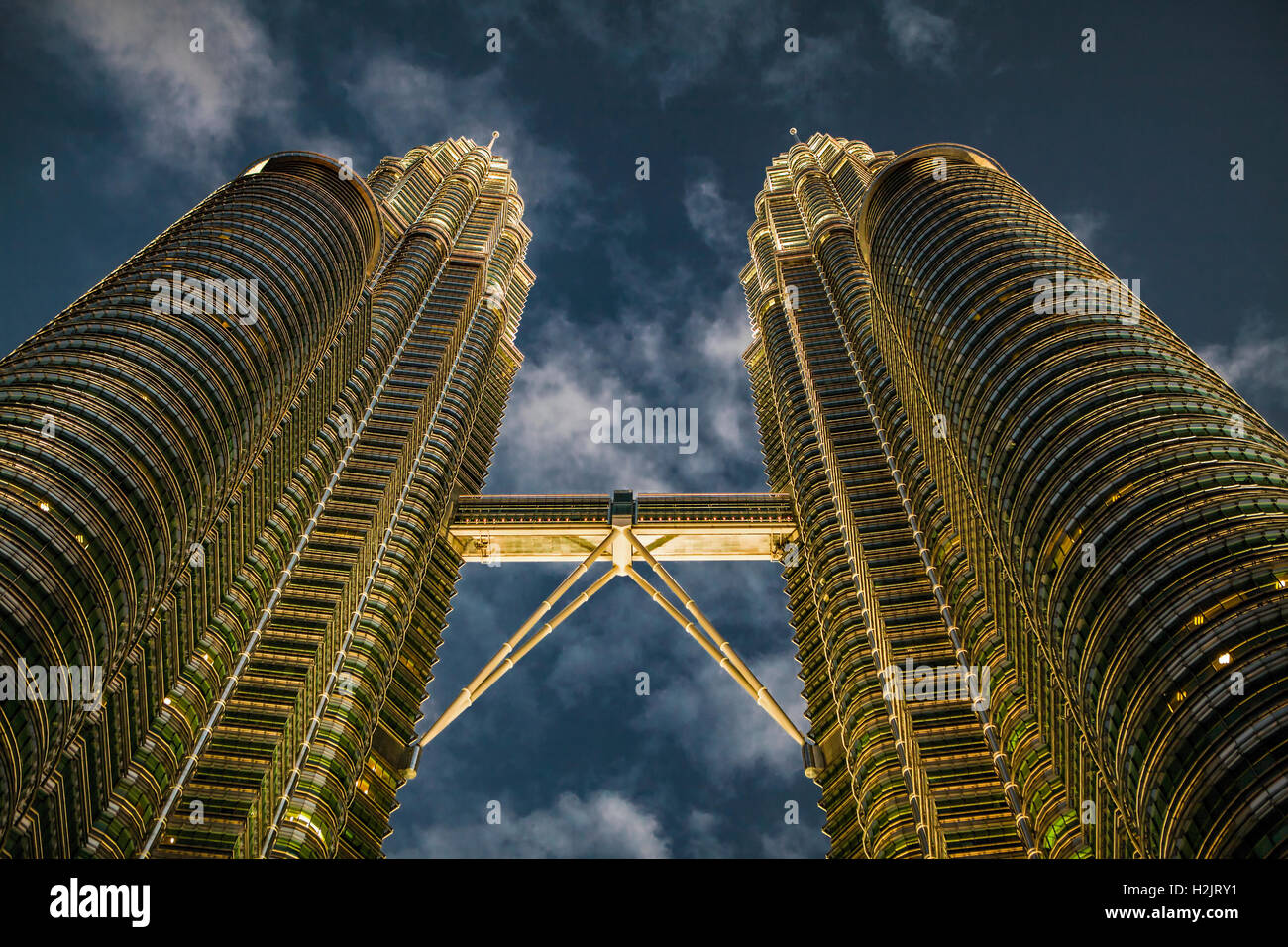 The petronas twin towers and skybridge glow a golden color in late the petronas twin towers and skybridge glow a golden color in late afternoon setting sunlight buycottarizona Gallery