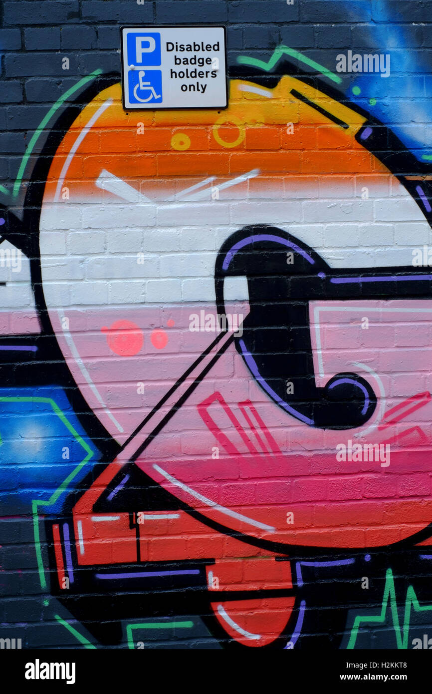 Graffiti wall uk - Stock Photo Colourful Graffiti Wall Art Spray Painted In Urban Area England Uk