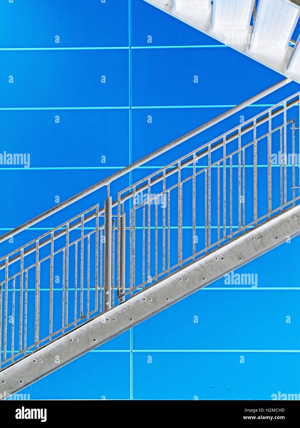 Industrial Staircase With Blue Panelled Wall Background.