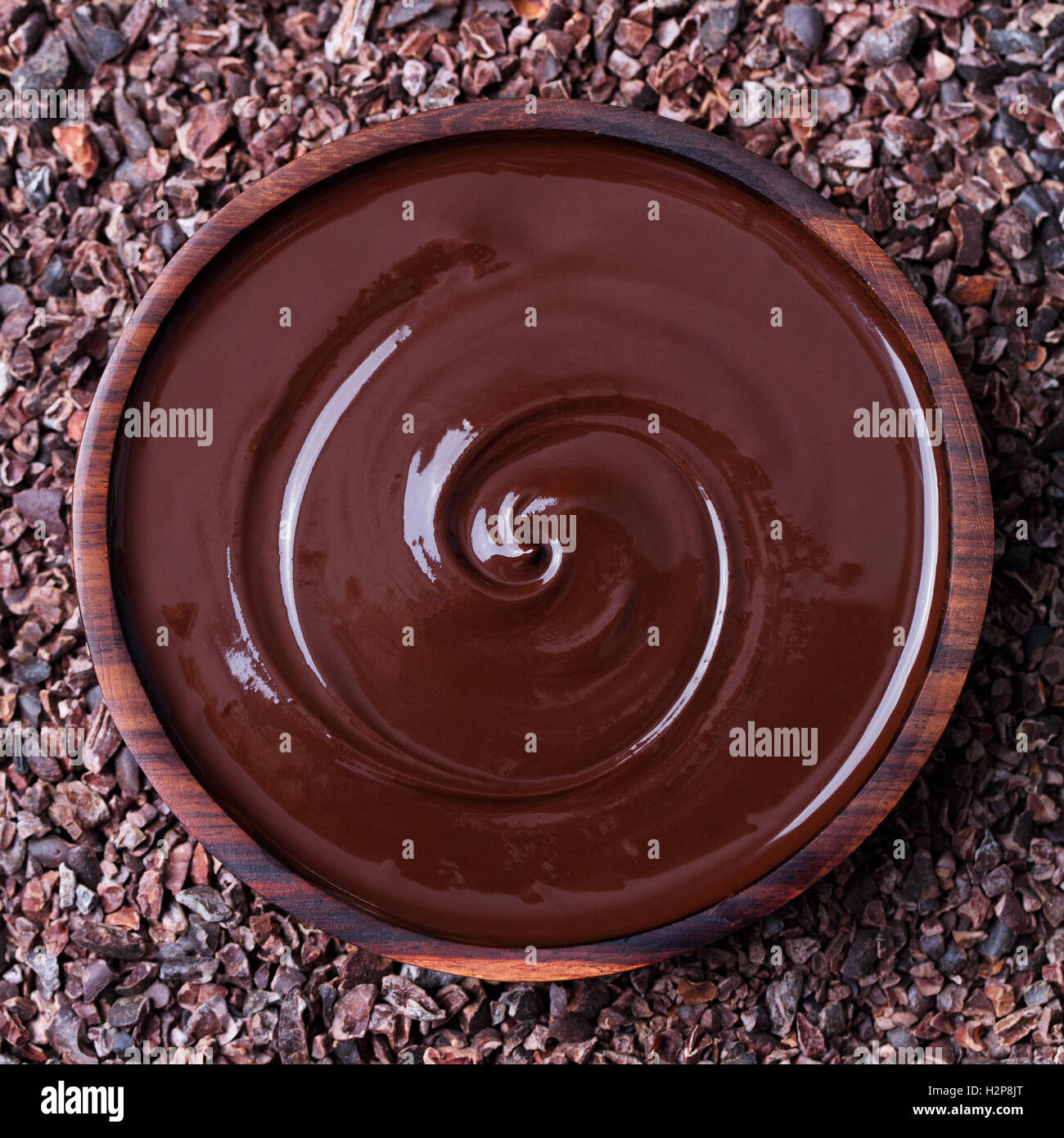 Bowl of melted chocolate on a crushed cocoa beans Stock Photo ...