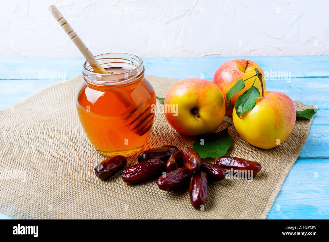 Honey jar dates and apples on burlap napkin rosh hashanah honey jar dates and apples on burlap napkin rosh hashanah concept jewesh new year symbols biocorpaavc