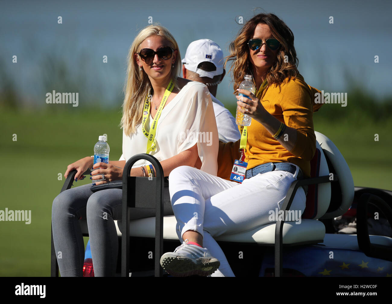 Helen storey right girlfriend of europe s lee westwood and nicole willett wife if europe s danny willett during the fourballs on day two of the 41st