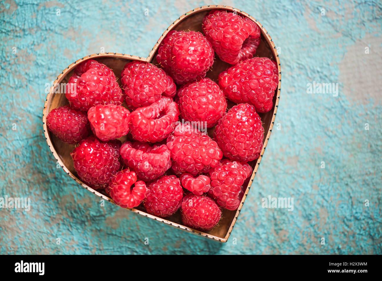 Raspberries in heart shape symbol love for fruits and healthy raspberries in heart shape symbol love for fruits and healthy living concept biocorpaavc