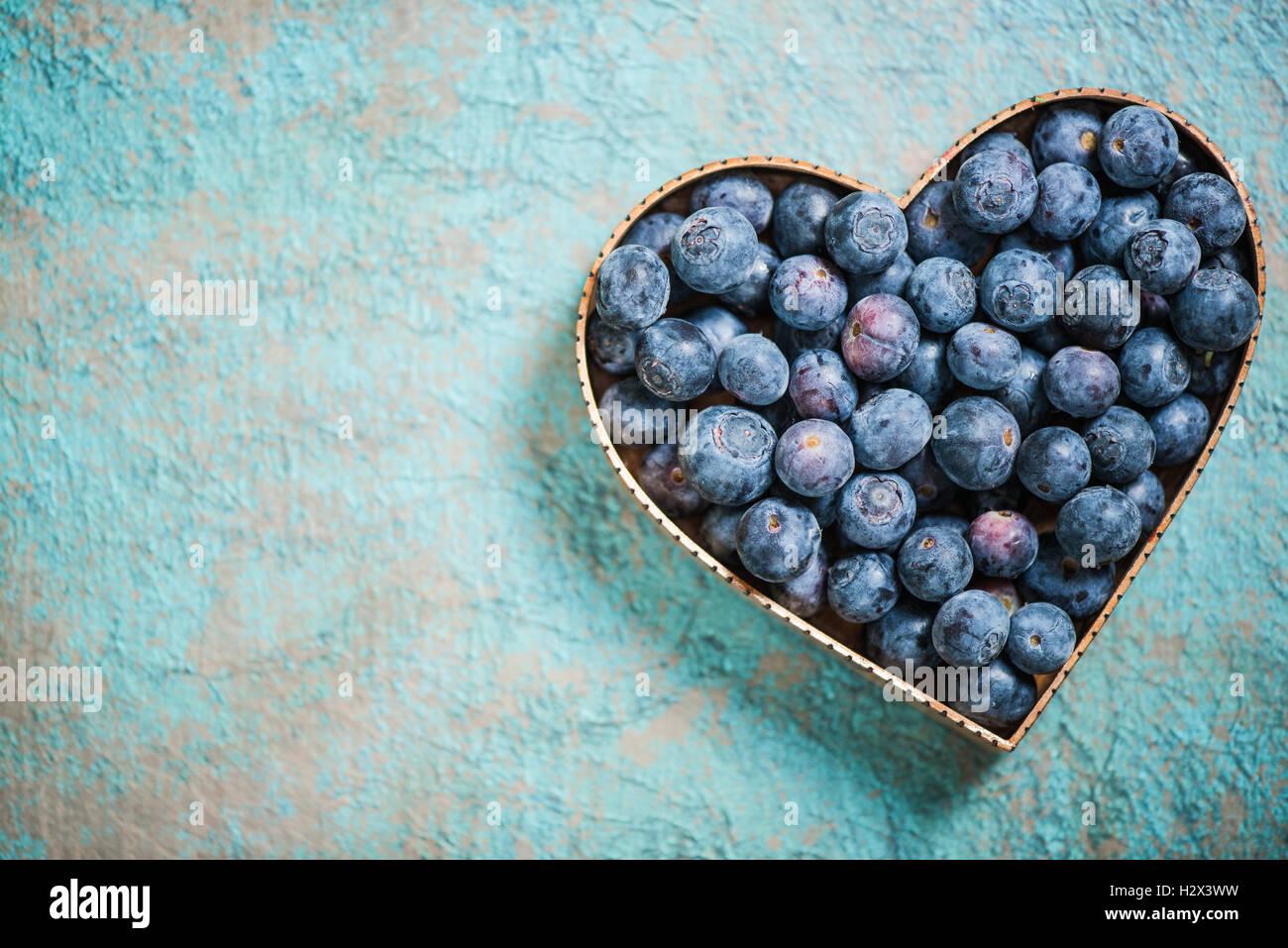 Blueberries in heart shape symbol love for healthy living and blueberries in heart shape symbol love for healthy living and eating concept biocorpaavc