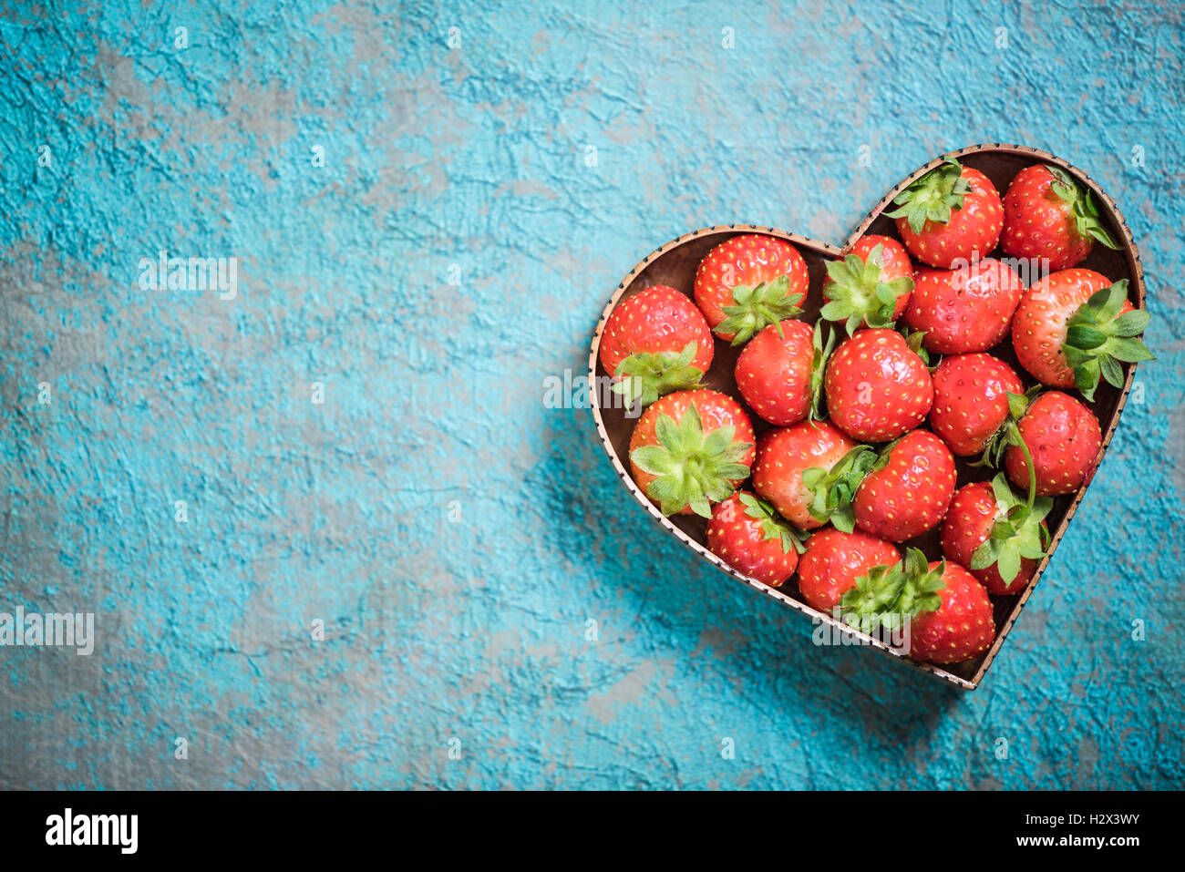 Strawberries in heart shape symbol love for healthy living and strawberries in heart shape symbol love for healthy living and eating concept biocorpaavc