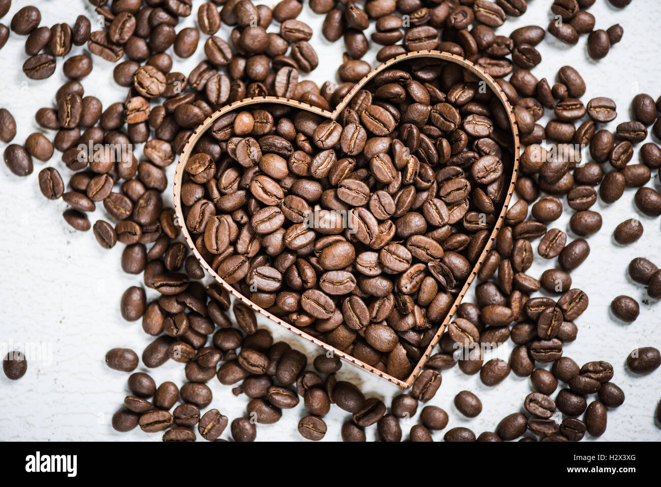 Heart shape symbol with roasted aromatic coffee beans stock photo heart shape symbol with roasted aromatic coffee beans biocorpaavc Image collections