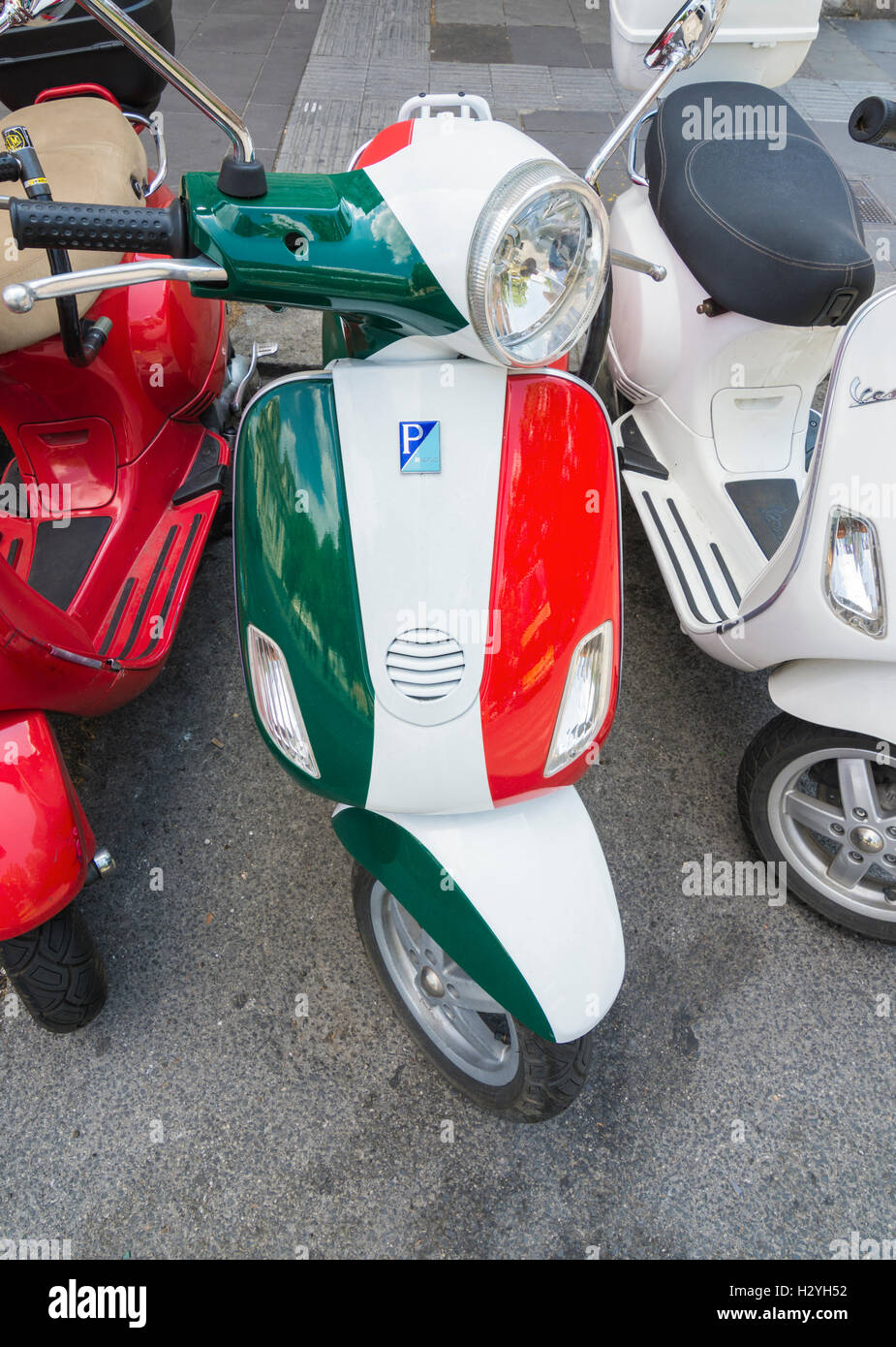 piaggio scooter in italian flag colours parked in a line of